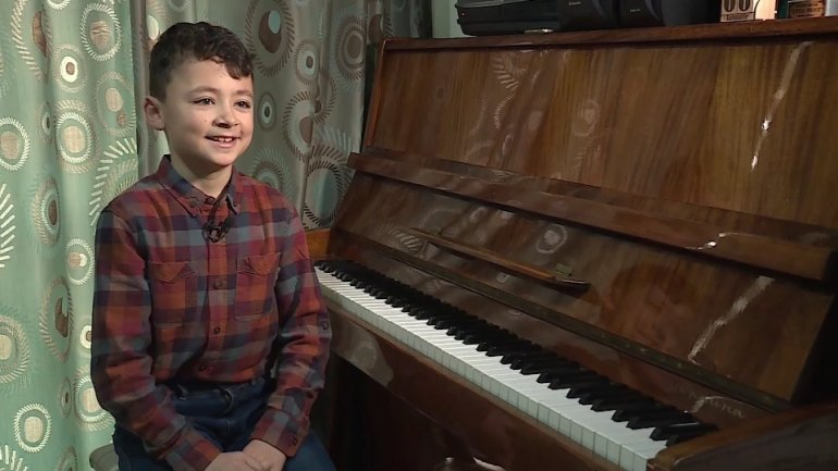Small boy with big dreams. 11-year-old Emanuel Oleinic dreams to sing in world's biggest opera houses