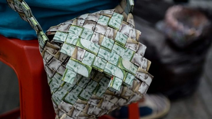 Street Seller From Venezuela Crafts Origami Style Items Out Of Money
