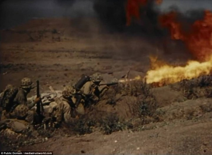 Incredible footage shows US Marines storming beaches at Iwo Jima and raiding bunkers with flamethrowers before hoisting the Stars and Stripes