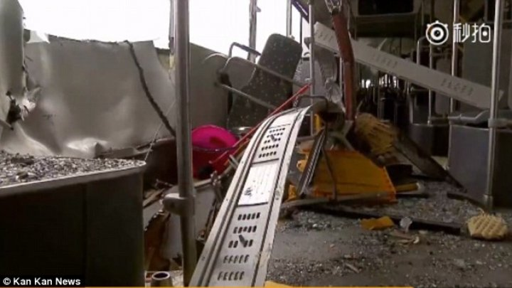 Metal rod fell from 28th floor of a skyscraper hitting a bus with passengers on board in Shanghai