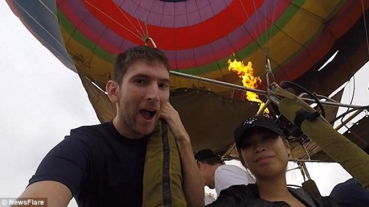 Romantic hot air balloon trip in Laos comes to a painful end as DRONE smacks tourist's girlfriend in the face