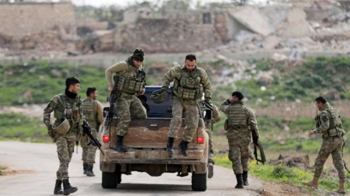 Turkish military says it has surrounded the Kurdish-held city of Afrin in northern Syria, focus on offensive against Kurdish militia