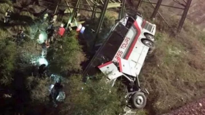 One person killed and many injured as bus carrying high school students plunged into a ravine off the side of an interstate highway in Alabama