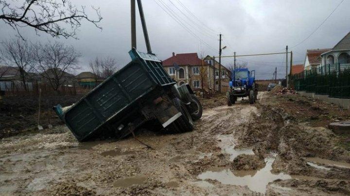 A truck trapped in muddy road in Mileştii Mici village