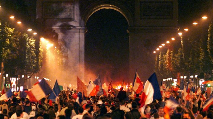 French football fans celebrate win in WC semi-final at the Champs Elysee
