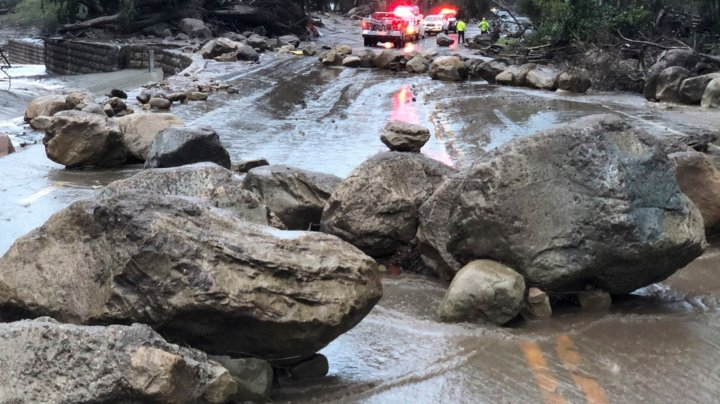 Clean up begins after flooding and mudslides kill at least 160