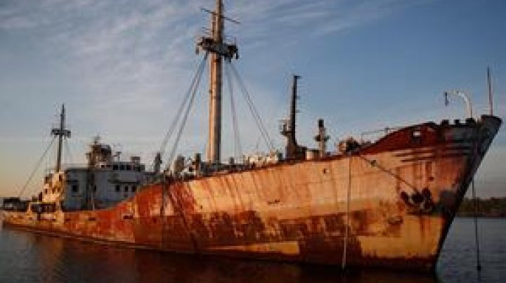 Greece pulls abandoned, half-sunken ships out of the sea