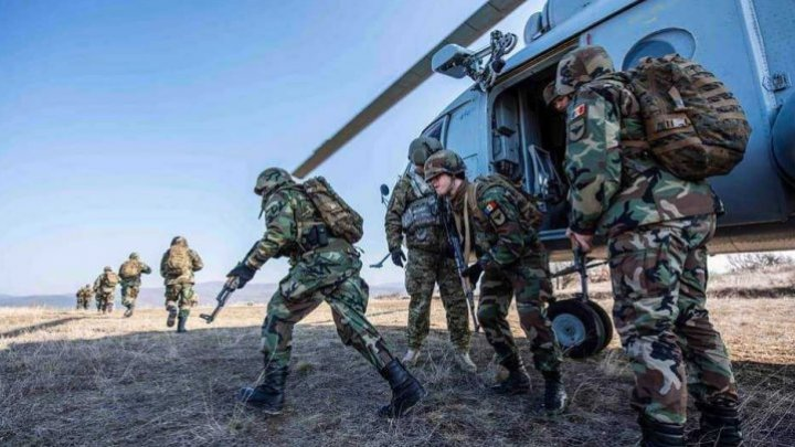 KFOR National Army militants participate in Kosovo field exercise