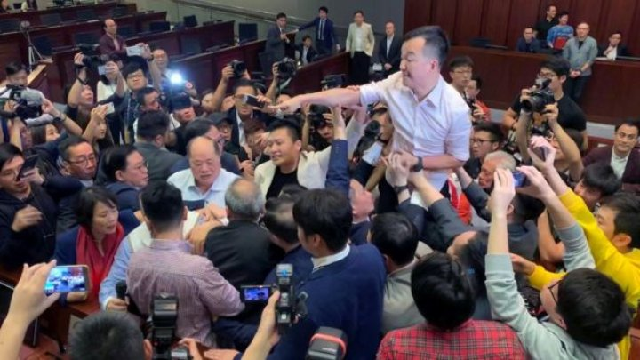 Hong Kong lawmakers brawl over contentious extradition law