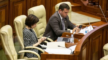 Maia Sandu is an unrelated MP. At least this information is shown in the Republic of Moldova's Parliament site