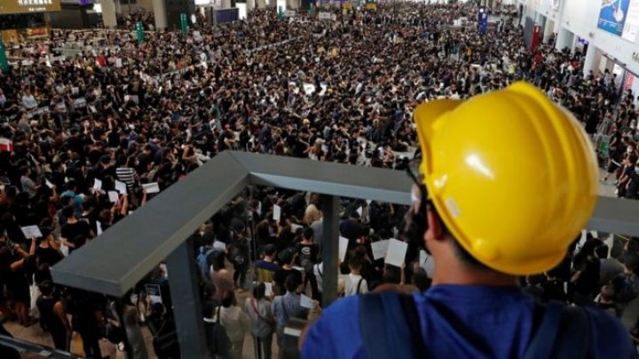 Hong Kong protests: International Airport cancelled departing flights, as anti-government protests continue for a fourth day