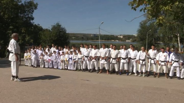 Dozens of karate fighters hold an outdoor training in Capital park