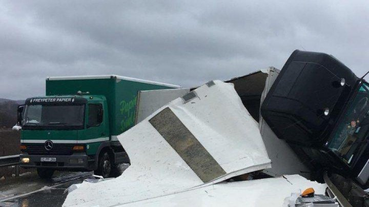 Unsettled weather plays havoc with traffic. TIR overturned on road causing congestion
