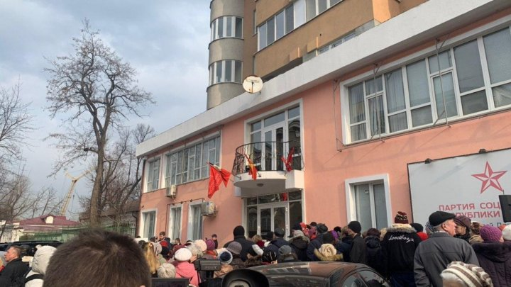 Thousands of people ally before Socialist Party headquarters in Moldova