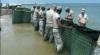 Militarii Gărzii Naţionale a SUA au ridicat ieri un baraj artificial în jurul insulei Dauphin, Alabama