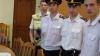 Poliţiştii au reţinut două persoane suspectate de alarme false cu bombă