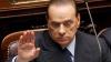 Berlusconi este acuzat că ar putea profita de noile măsuri de austeritate, care l-ar scuti de o datorie mai veche