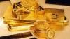 Aurul - principalul refugiu pentru investitori. Preţul unei uncii a atins azi cel mai înalt nivel din istorie