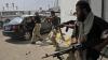 Rebelii şi forţele pro-Gaddafi luptă pentru ultimele oraşe rămase sub controlul lui Gaddafi
