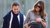 Nicolas Sarkozy şi Carla Bruni au ieşit pentru prima dată la plimbare cu micuţa Giulia (FOTO)