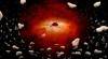Gaura neagră din centrul Căii Lactee se hrăneşte cu asteroizi