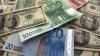 Leul s-a depreciat în raport cu euro şi valuta românească
