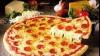 Iată cum arată magnetul de frigider cu ajutorul căruia poţi comanda pizza