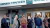 Grecii îşi retrag banii din bănci. Aproximativ 800 de milioane de euro pe zi