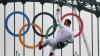 Flacăra olimpică, în mâinile lui Bear Grylls. Cum a transportat-o fostul star Discovery VIDEO