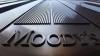 "Moody""s a retrogradat ratingul a 15 bănci"