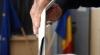 Românii îşi aleg noul Parlament în condiţii meteo extreme. Peste 20% din alegători au votat până la ora 14.00