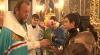Opt copii de la un internat din Capitală, botezaţi azi de Mitropolitul Vladimir