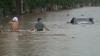 Inundaţii puternice în China. Zeci de locuinţe şi maşini se află sub ape VIDEO