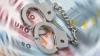 Poliţist REŢINUT ÎN FLAGRANT cu mită de 500 de euro