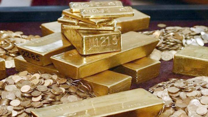 Preţul aurului a scăzut cu aproape 25 de dolari. CLICK pentru a afla motivul