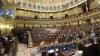 Fete pe jumătate dezbrăcate în Parlamentul Spaniei. Deputaţii din opoziţie au aplaudat