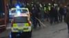Cel puţin patru persoane, printre care şi doi poliţişti, răniţi în timpul unui marş antirasist