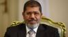 Mohamed Mursi, în boxa acuzaţilor. Fostul preşedinte al Egiptului este învinuit că a evadat din închisoare