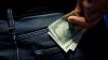 Bărbat reţinut pentru trafic de influenţă: I-a spus unui şofer că îi poate rezolva problema cu 1.000 de dolari
