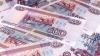În luna decembrie rubla rusească a egalat dolarul la volumul de unităţi schimbate