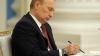 Vladimir Putin a SEMNAT actul prin care Crimeea şi Sevastopolul devin subiecţi ai Federaţiei Ruse (VIDEO)