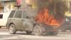 Zi cu ghinion pentru o şoferiţă. Maşina în care se afla a luat FOC în plină stradă (VIDEO)