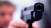 ATAC ARMAT la o bancă din Chişinău. Doi angajaţi au fost împuşcaţi