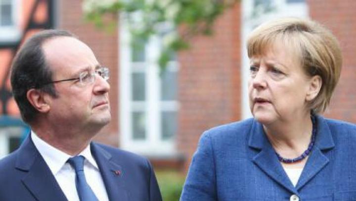 Merkel și Hollande amenință Moscova şi cer Kievului să se abțină de la acțiuni ofensive