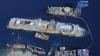 Costa Concordia, în ultima sa călătorie. Vasul de croazieră a ajuns în portul Genova, unde va fi dezmembrat