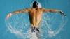 Amatori şi profesionişti au concurat la trecerea înot a lacului de la Ghidighici (VIDEO)