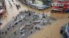 Inundaţiile iau vieţi de oameni în China şi răvăşesc Statele Unite