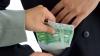 Reţinut ÎN FLAGRANT. Un poliţist a cerut mită de 1.000 de euro