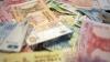 CURS VALUTAR: Moneda naţională se depreciază în raport cu principalele valute de referință