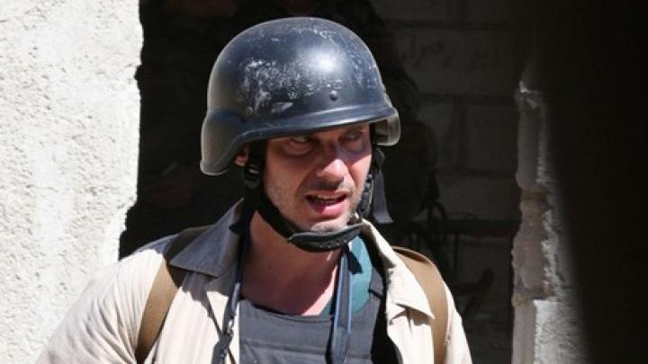 CONFIRMAT. Un fotograf al agenției de presă RIA Novosti a fost ars de viu în estul Ucrainei